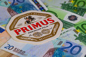 Beermat from Primus beer and EUR money. — Stock Photo