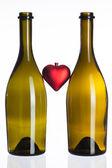 Empty bottles of wine and love symbol — Stock Photo