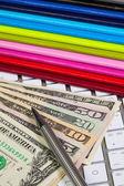 Business desk - Twelve diaries,US dollars,pen and computer — Stock Photo