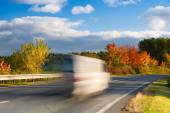 Speed car on a road in Krkonose mountain — Stock Photo