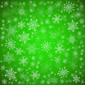 Green Christmas background with different snowflakes — Stock Vector