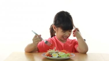 HD footage close up of young girl doesn't like eating vegetables — Stock Video