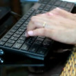 HD footage Close up of a young woman typing on a laptop keyboard — Stock Video #55291661