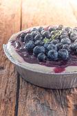Blueberry cheese pie cake on wood table — Stockfoto