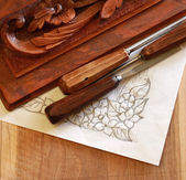 Carpenter wood chisel tool with carving and drawing — Stock Photo