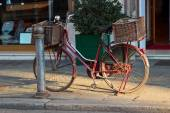 Old vintage bicycle with big basket on the street of old town Pa — Stock Photo