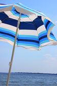 Sun umbrella over blue sky — Stock Photo