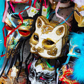 VENICE, ITALY - JANUARY 2, 2015: Sale of festive masks in the st — Stock Photo
