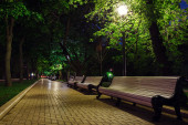 Benches and pavement in the light — Stock Photo