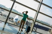 Beautiful young woman at the airport — Stock Photo