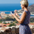 Young girl tourist uses a tablet — Stock Photo #55721027