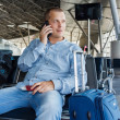 Beautiful young man at the airport — Stock Photo #57761049