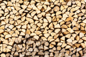 Stack birch firewood in Russia — Stock Photo