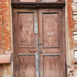 Old wooden door in the wall — Stock Photo #58595665