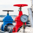 Manometer, red valve on hot pipe — Stock Photo #59386311