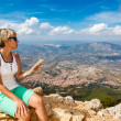 Young woman and panoramic view from the mountains — Stock Photo #60454567