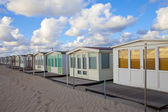 Several beachhouses in a row on beach in The Netherlands — Stock Photo