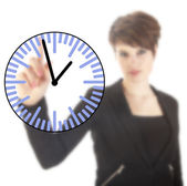Young businesswoman with clock isolated on white background — Stock Photo