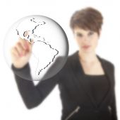 Young businesswoman with earth globe isolated on white background — Stock Photo