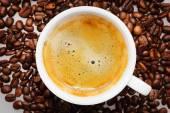 Coffee on coffee beans — Stock Photo