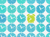 Time concept: green alarm clock icon on wall background — Stock Photo