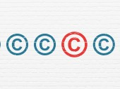 Law concept: copyright icon on wall background — Stock Photo