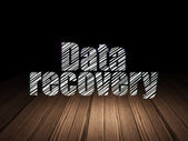 Information concept: Data Recovery in grunge dark room — ストック写真