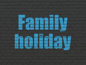 Travel concept: Family Holiday on wall background — Stock Photo