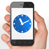 Timeline concept: Hand Holding Smartphone with Clock on display — Stock Photo