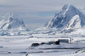 Scientific Antarctic station winter day on a background of mount — Stock Photo