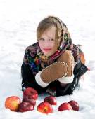 Winter portrait of the beautiful girl.Beautiful girl with red apples on snow — Stock Photo