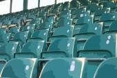 Empty green grandstand seating in a regular symmetrical pattern — Stock Photo