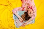 Girl sleeping on the yellow sheet — Stock Photo