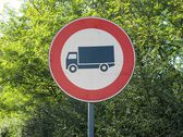 No entry road sign with truck — Stock Photo