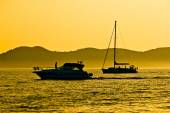 Yacht and sailboat silhouette at golden sunset — Stock Photo