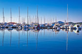 Sailboats and yachts in harbor reflections view — Stock Photo