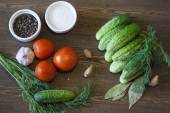 Cucumbers, tomatoes and spices — Stock Photo