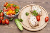 Fried pork steak with vegetables and parsley on a wooden board — Stock Photo