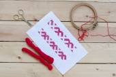 Ukrainian national red embroidery thread, selective focus — Stock Photo