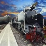Stream engine locomotive train on railways track with beautiful — Stock Photo #52801263