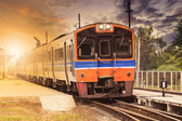 Diesel engine trains on track ways station against beautiful dus — Stock Photo