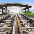 Railways track and bridge cross over with urban scene behind use — Stock Photo #53338457