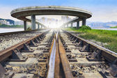 Railways track and bridge cross over with urban scene behind use — Stock Photo