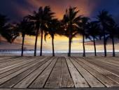 Old wood terrace on sea beach with coconuts tree and beautiful d — Stock Photo