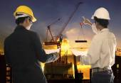 Two civil engineer working in building construction site against — Stock Photo