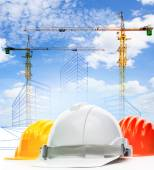 Safety helmet against sketching of building construction with li — Stock Photo