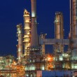 Oil refinery plant in petrochemical industry estate at night tim — Stock Photo #54138405