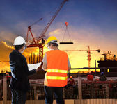 Engineering man working in building construction site with worke — Stock Photo
