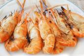 Fresh water shrimp grilled on fire ready to eat on white dish — Stock Photo