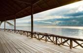 Wood terrace in wooden pavillion against peaceful of heaven sea — Stock Photo
